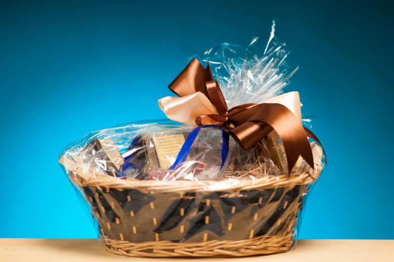 A gift basket isolated against a blue background