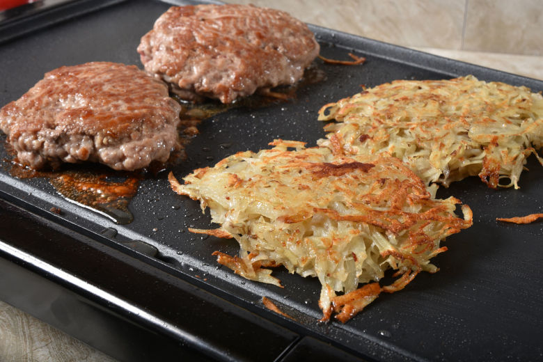 Sausage patties and hashbrowns on an electric griddle
