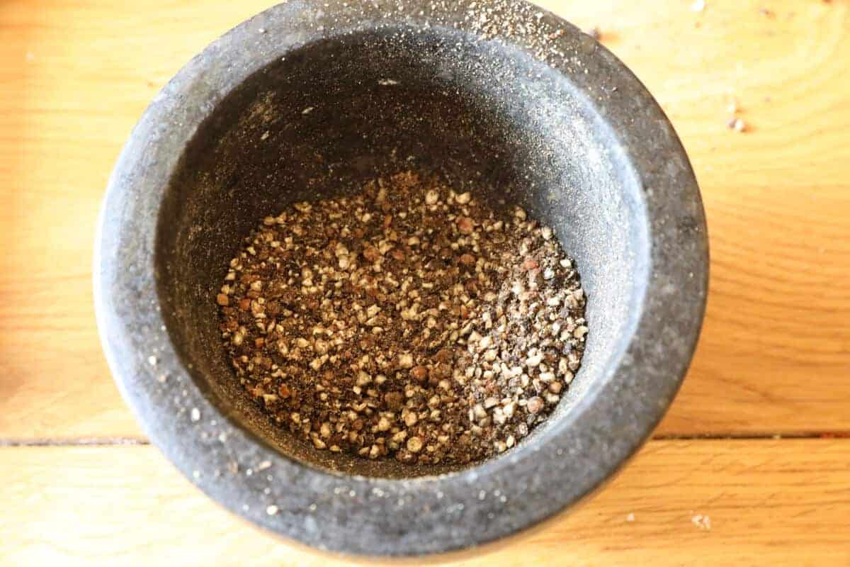 Close up of a dry rub prepared in a pestle and mortar