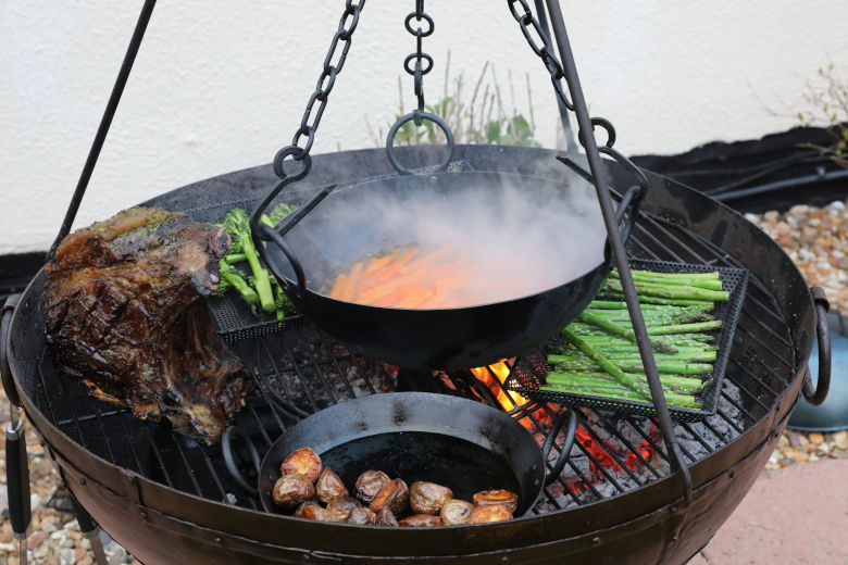 Forerib of beef and veg cooking over a kadai fire