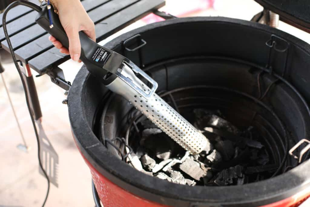 Close up of a Looftlighter being used to light a Kamado Joe grill and smoker