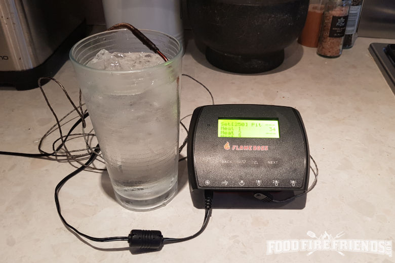 Flame boss 500 with probe inserted into a glass of iced water