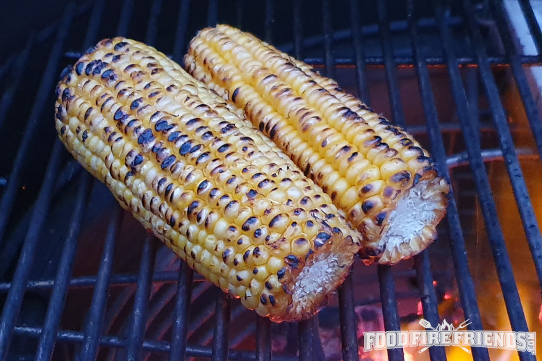 2 corn on the cob on a grill