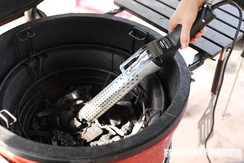 Looftlighter held in a kamado Joe, about to light lumpwood charcoal