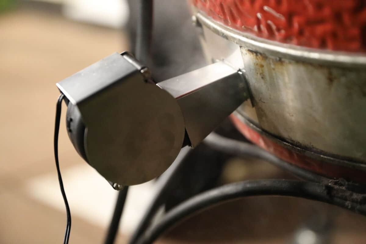 Close up of flame boss 500 blower attached to a kamado joe