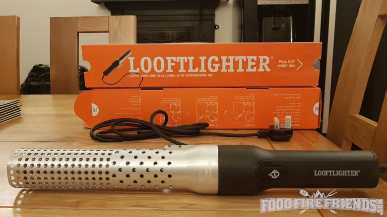 A Looftlighter in front of it's orange box packaging on a wooden table