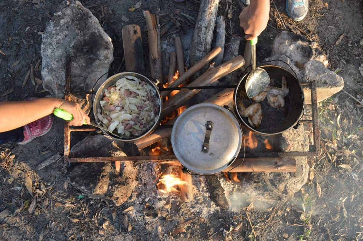 Some pots and pans on an open fire for cooking