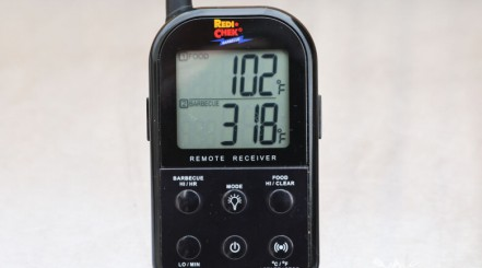 Maverick ET732 thermometer receiver isolated on a silver table