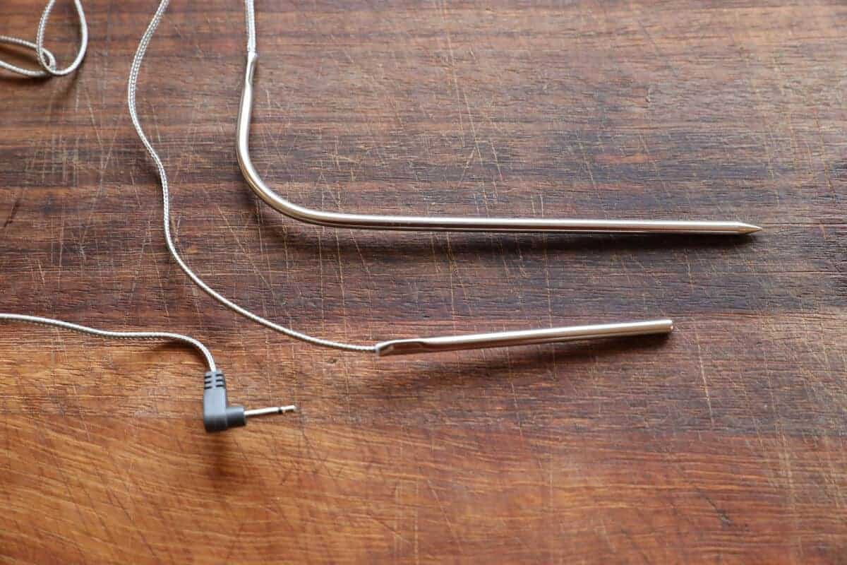 2 different length thermometer meat probes on a wooden board