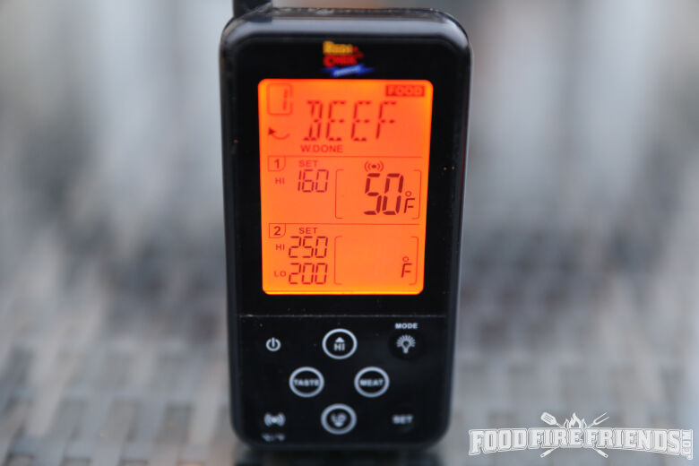Maverick ET733 thermometer receiver isolated on a silver table