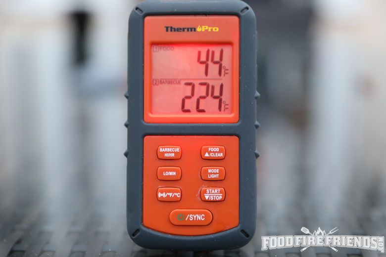Close up of a Thermopro tp20 thermometer receiver with a blurred background