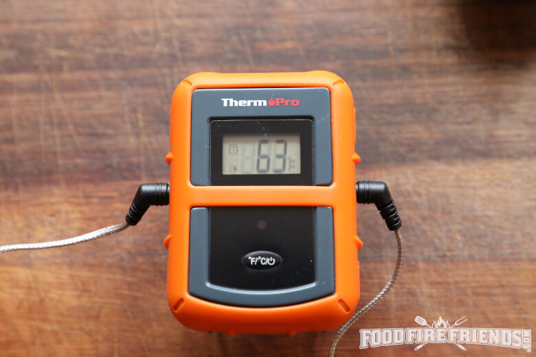 Thethermopro tp20 thermometer transmitter on a chopping board