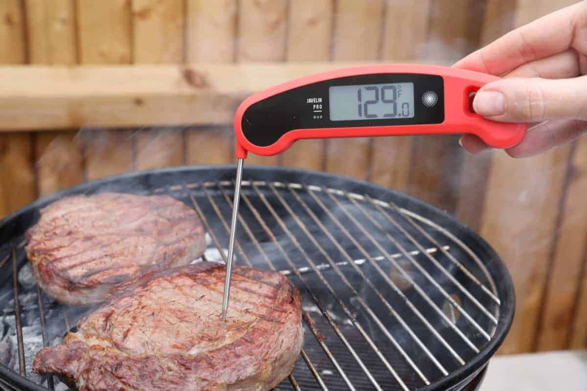 lavatools javelin pro instant read thermometer reading the temp of a steak on a grill