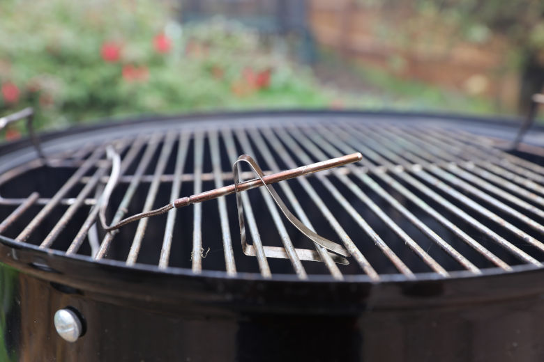 Thermometer probe on a charcoal grill grate