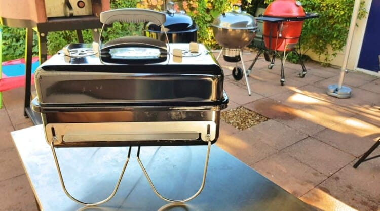 Weber go anywhere tabletop grill on a stainless steel table