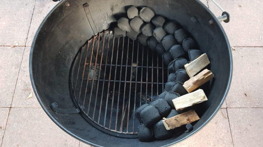 Close up of a charcoal snake setup for grilling