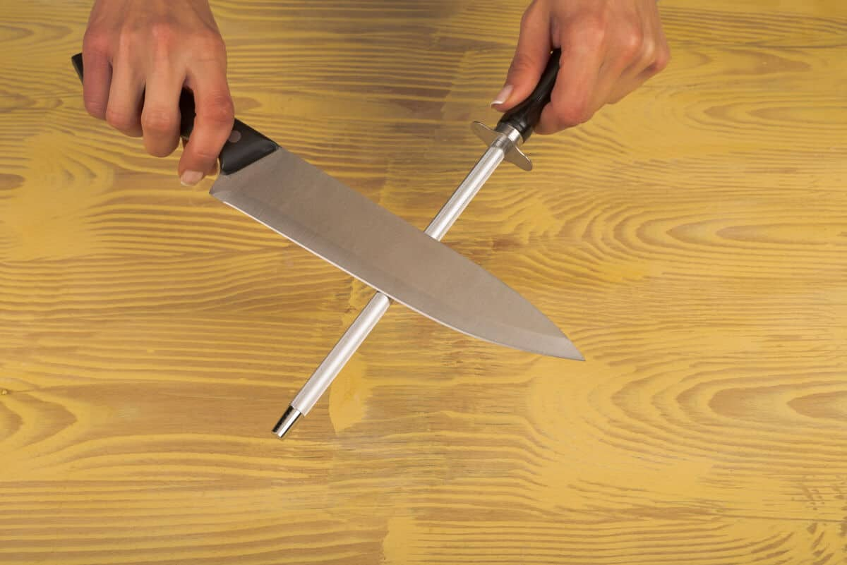 Image of a knife sharpening steel being used to hone a kitchen knife