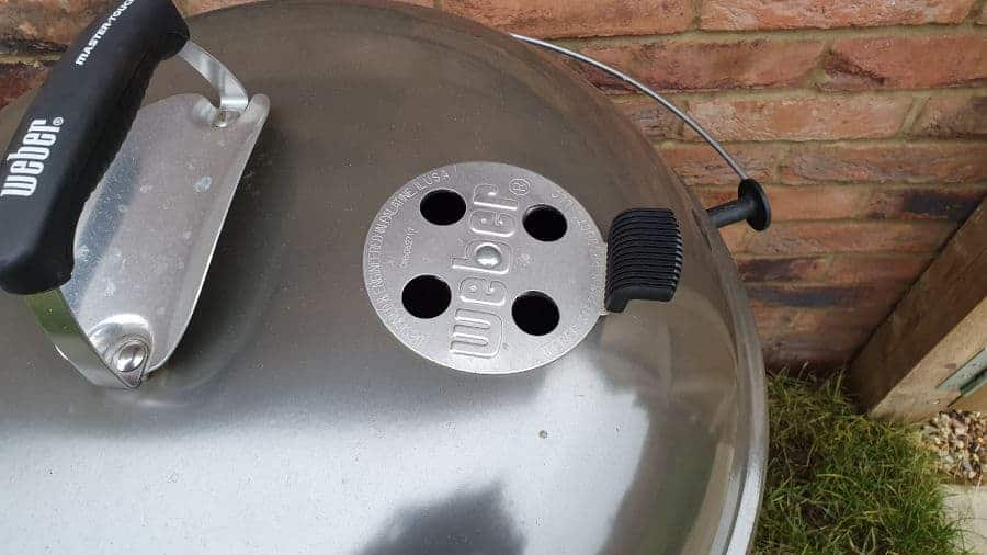 Close up of a weber kettle top lid vent