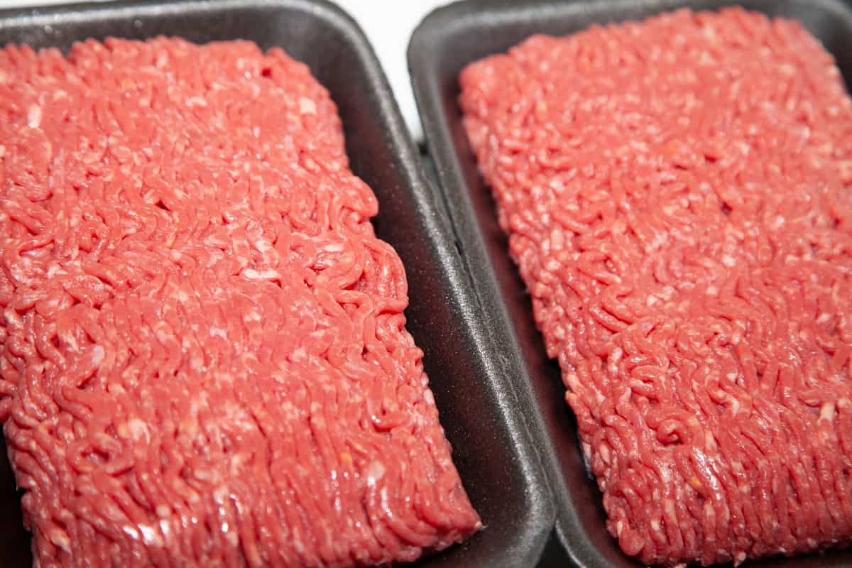 Two packets of ground beef side by side