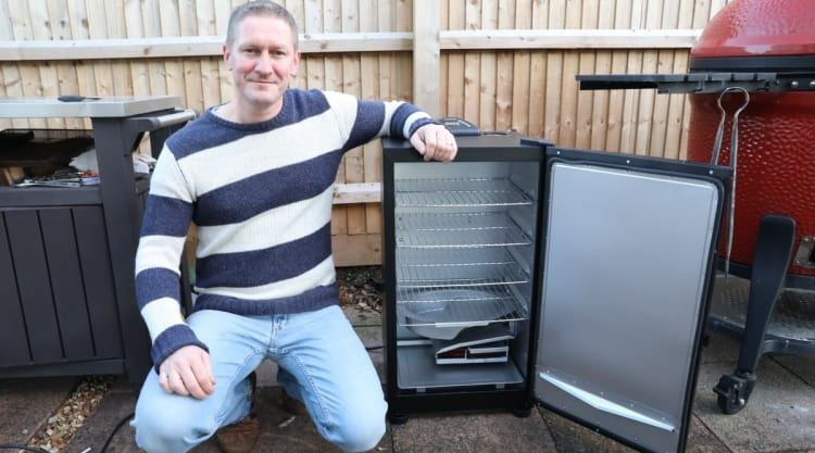 me sitting with my arm resting on my new Masterbuilt electric smoker