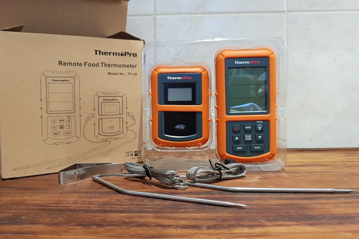 Contents of Thermopro tp20 thermometer box laid out on a chopping board