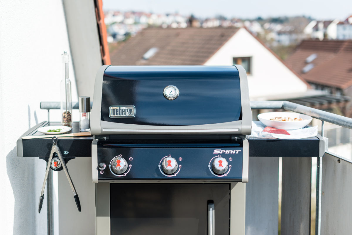 Weber 3 burner gas grill with the lid closed on a balcony
