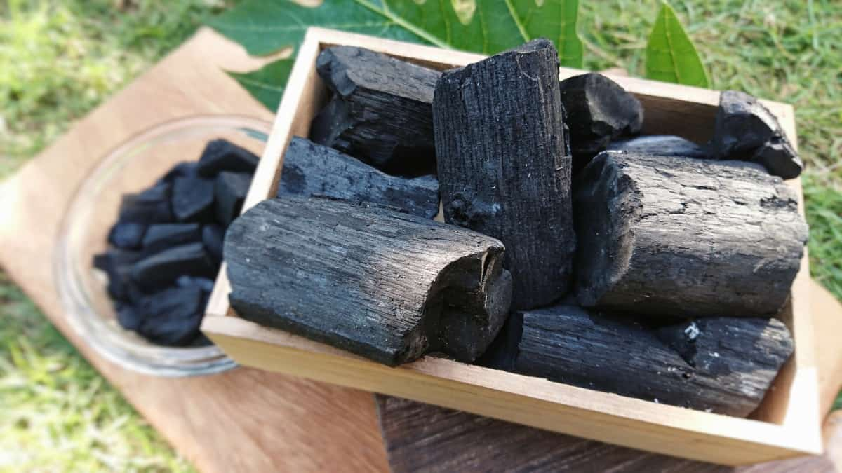 Fine looking natural hardwood charcoal in a wooden basket