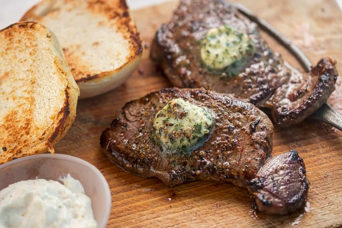 Barbecued ranch steak with melting compound butter