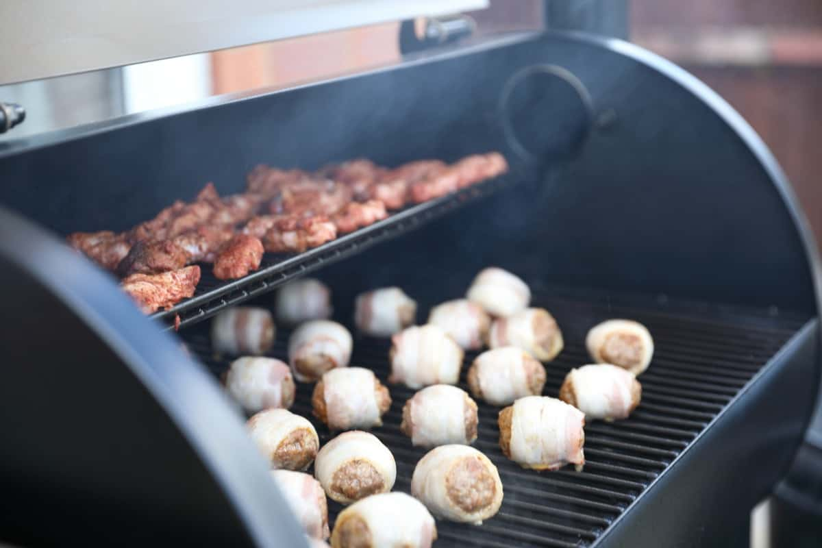 Chicken wings and moink balls in a pellet grill