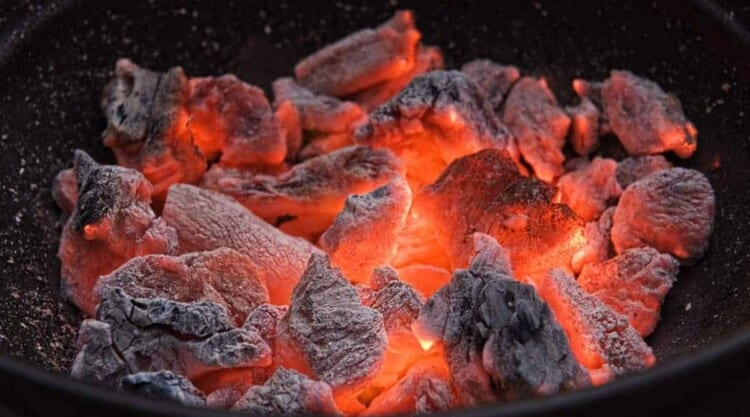 A charcoal grill full of hot, burning embers