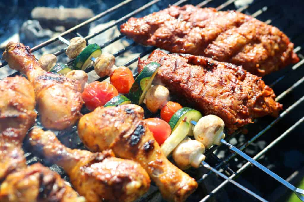 Kebabs and pork on a charcoal grill