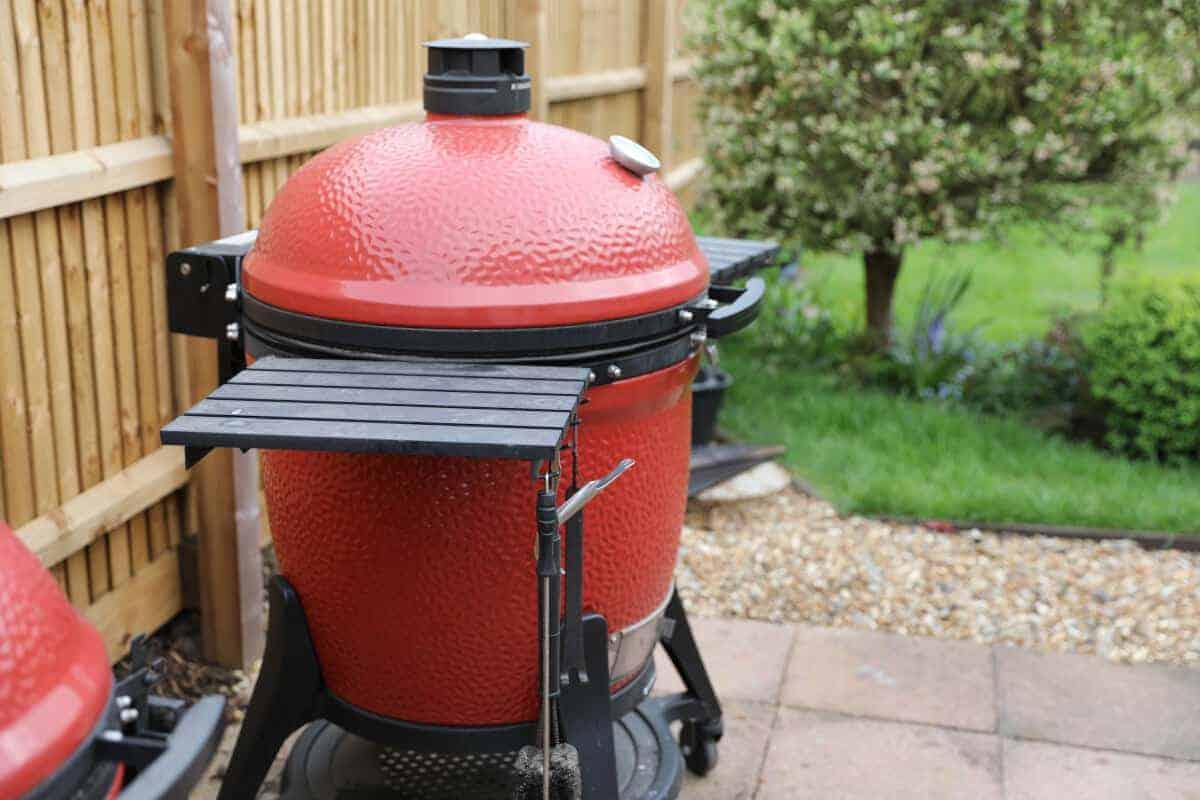 Side view of kamado joe grill in a garden