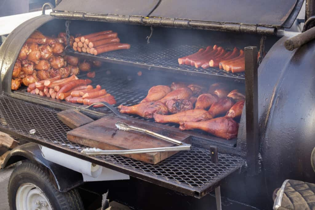 a large bbq smoker loaded with meats