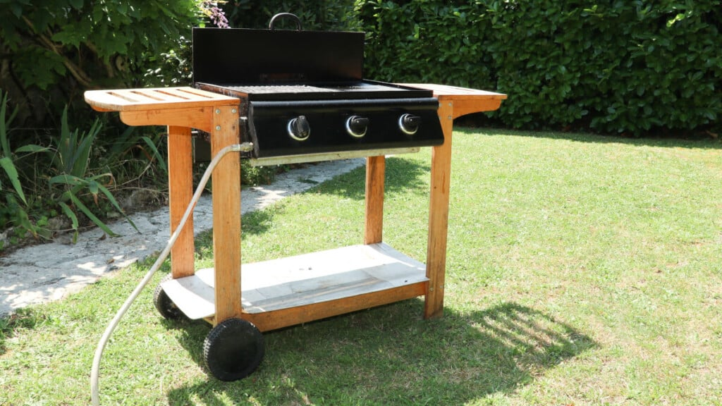 dedicated flat top gas grill on a grass lawn