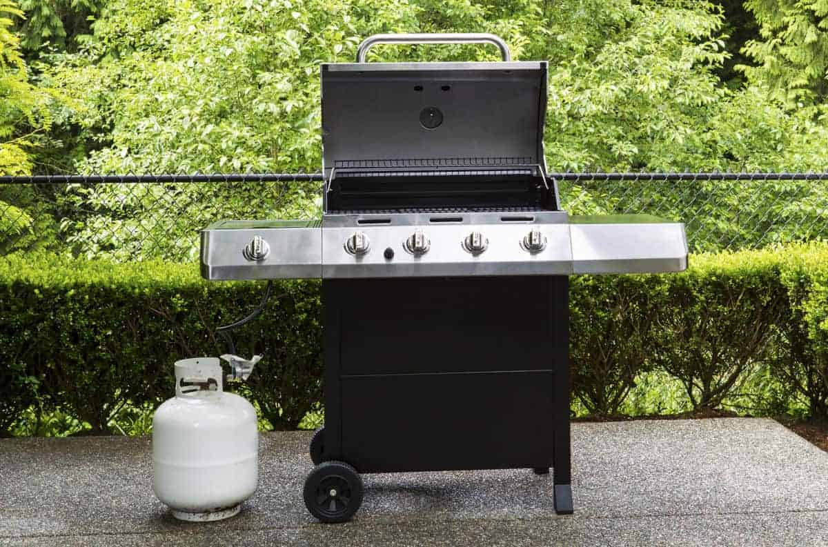 gas grill with propane bottle