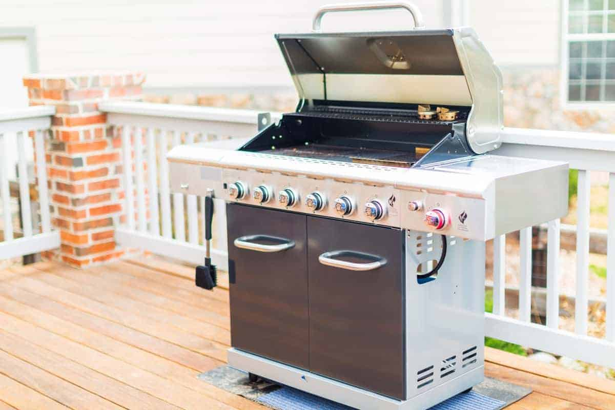 large 6 burner gas grill on a wooden deck