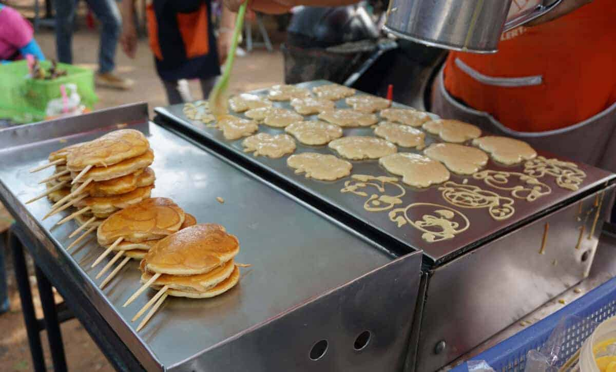 pancakes cooking on a dedicated griddle