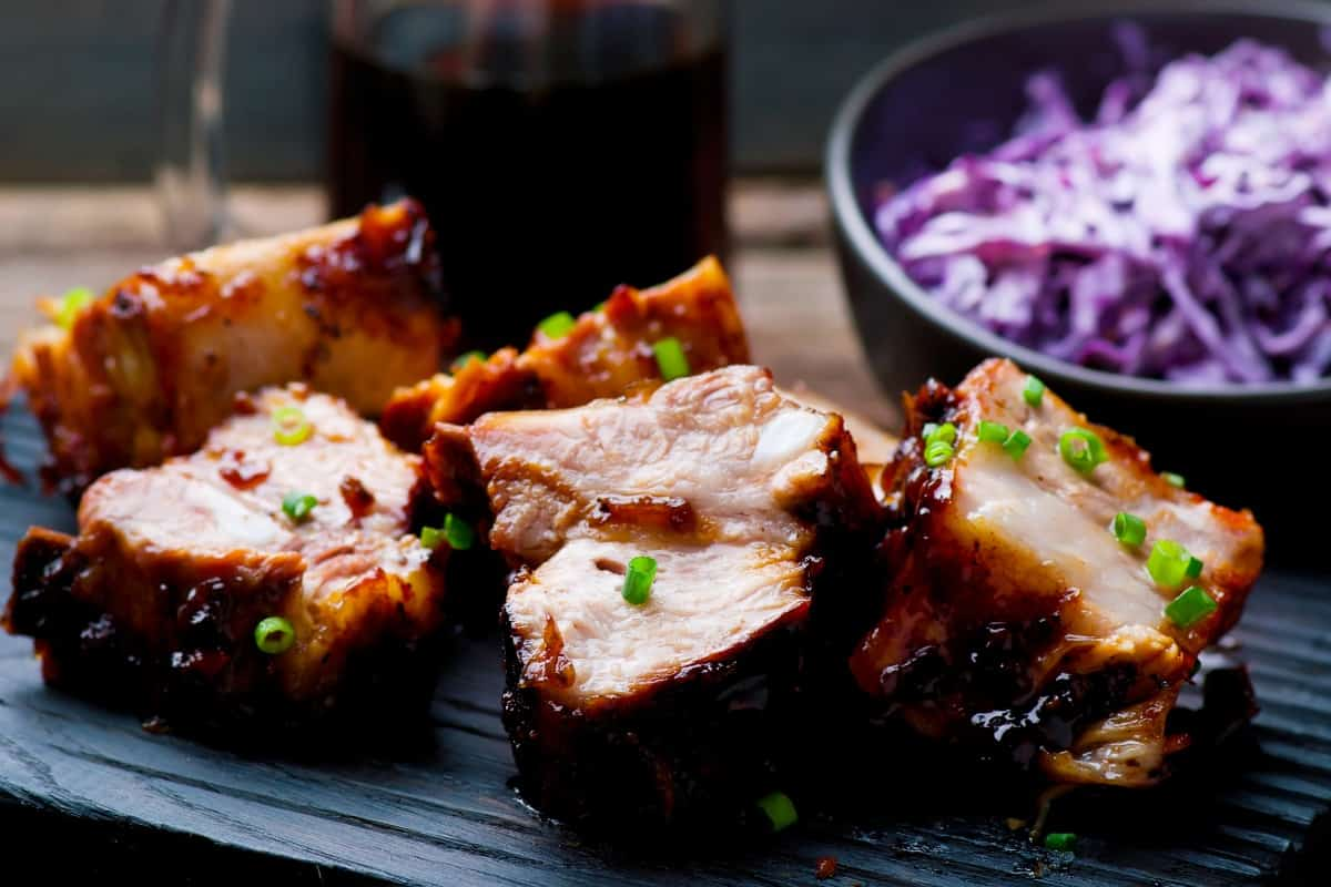 rustic country style ribs with bowl of red cabbage