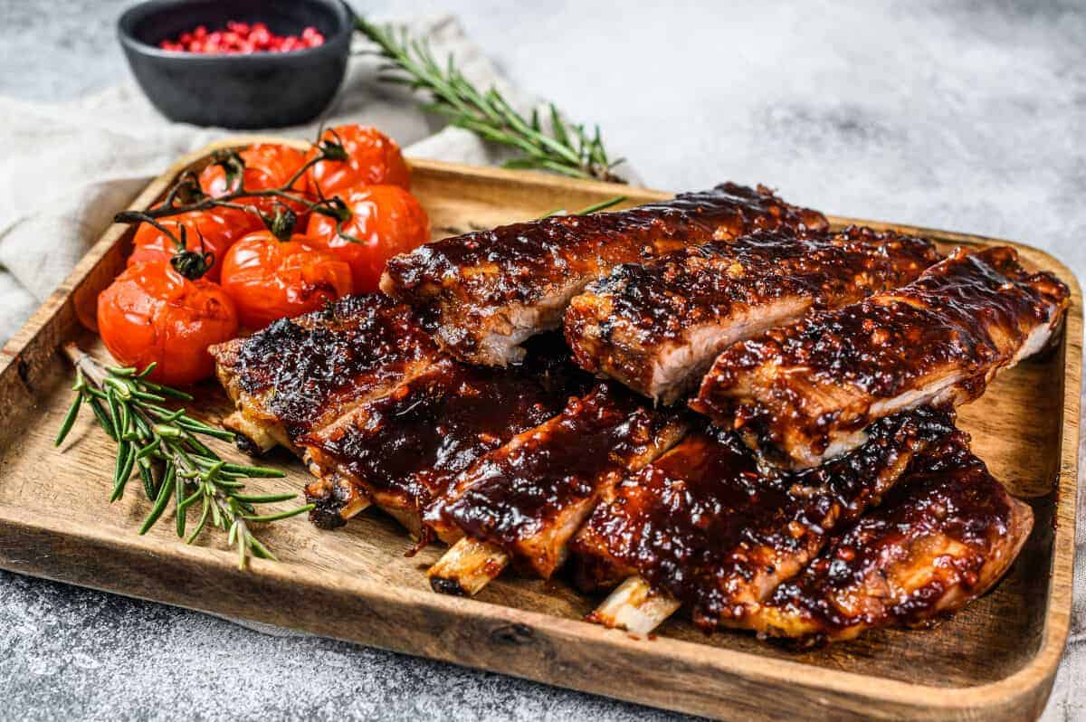 bbq spare ribs, with a thick glaze and roasted cherry tomatoes