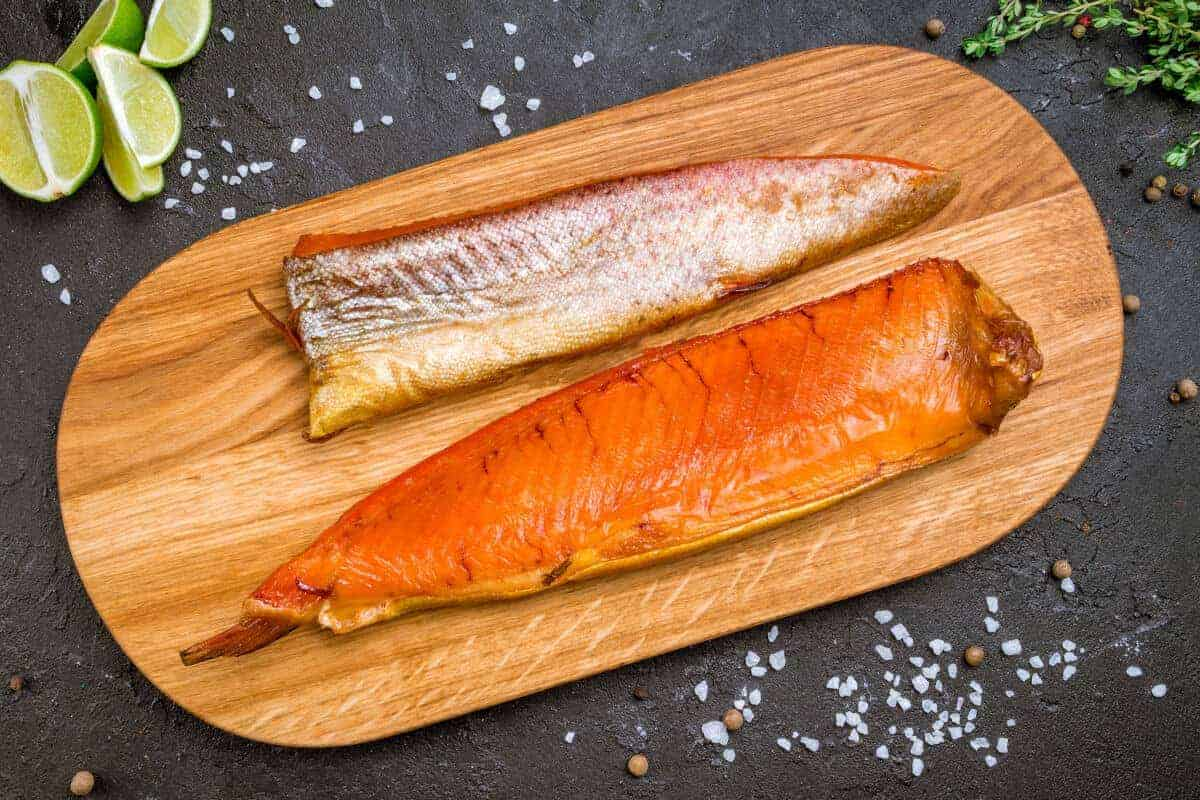 Two hot smoked trout filet on a wooden board