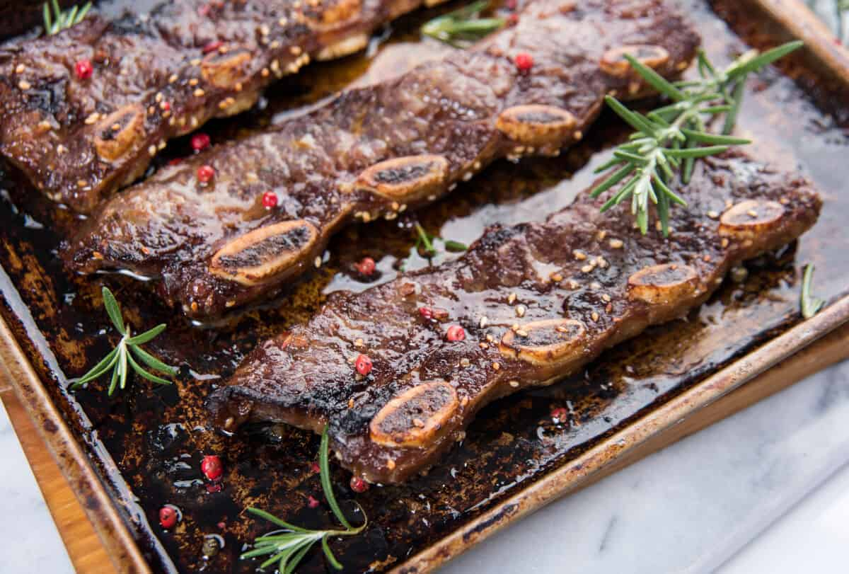 flanken cut beef short ribs, cooked with a marinade and rosemary