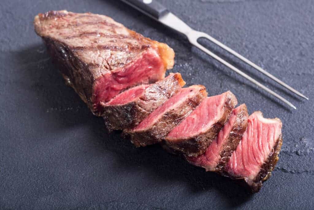 A grilled then sliced new york strip steak