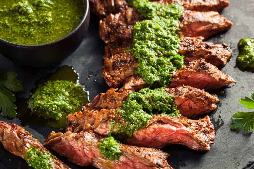skirt steak, sliced, drizzled with a chimichurri sauce