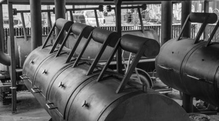 black and white image of large smokers in an American smokehouse