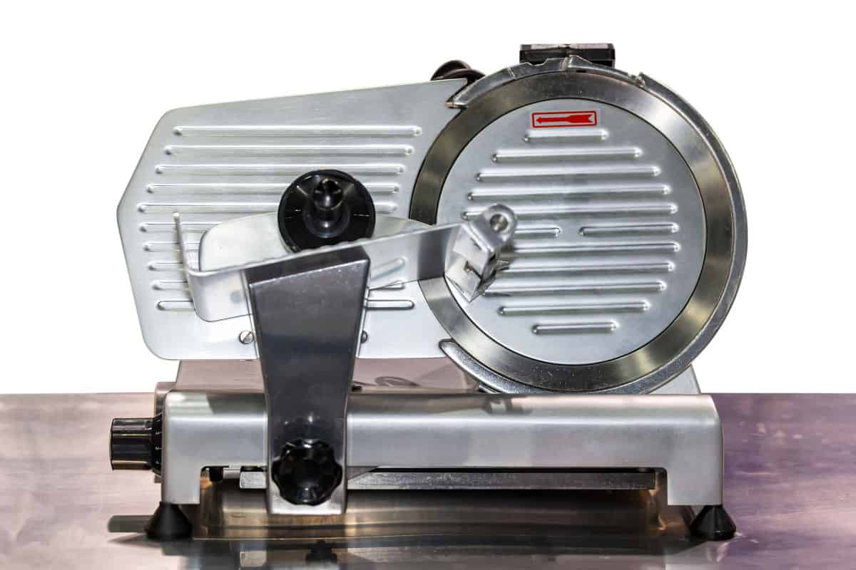 Front view of a commercial grade semi-automatic electric meat slicer