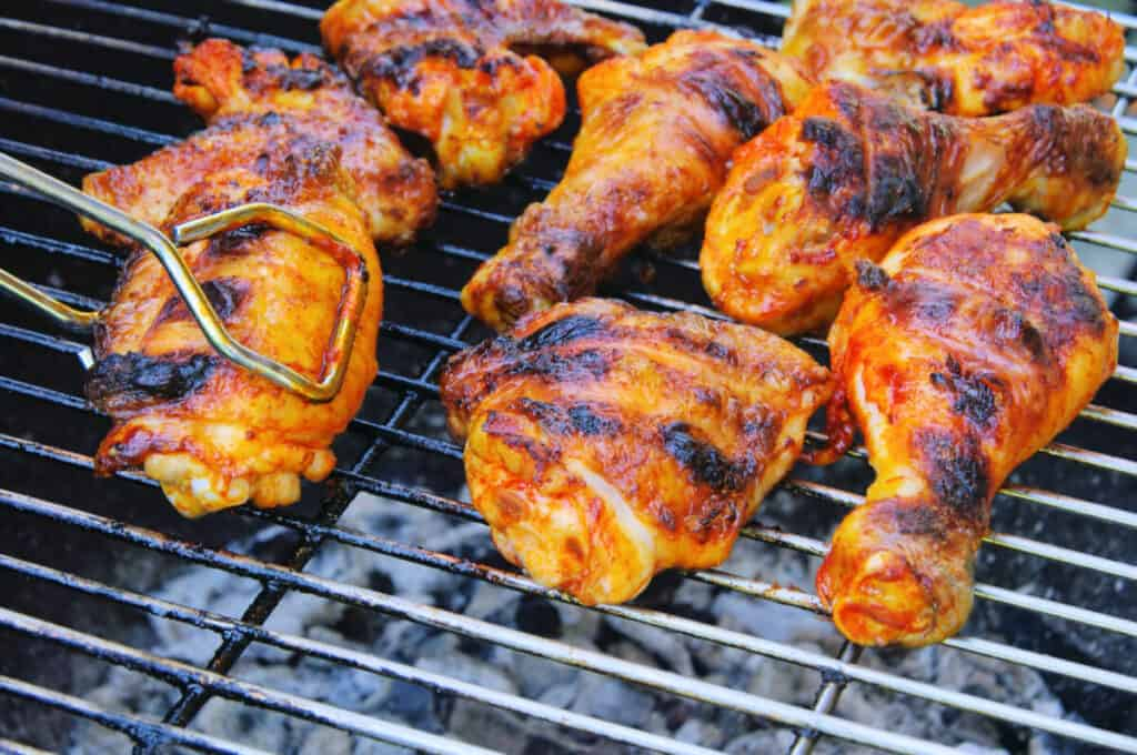 Chicken legs on a hot grill