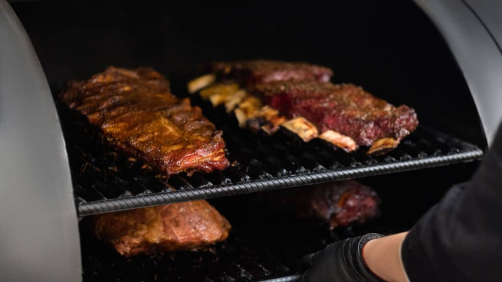 beef ribs in a bbq smoker