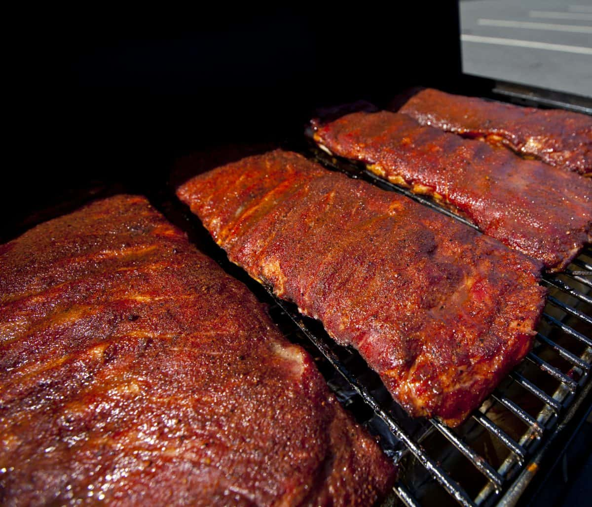 Racks of spare ribs in a smoker
