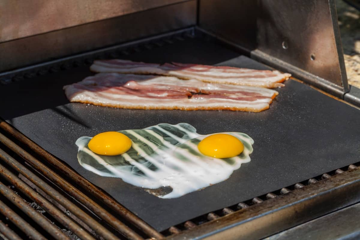 eggs and bacon on grill mat