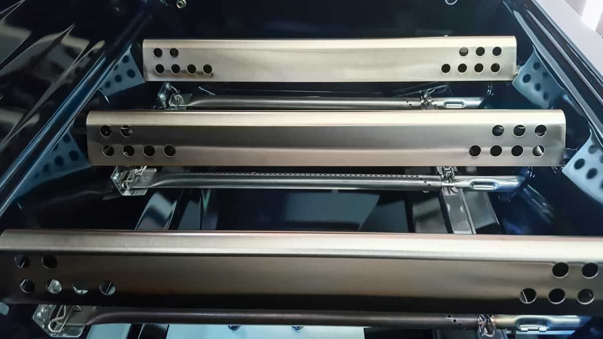 A look at a gas grills flavorizer bars, with the grates removed